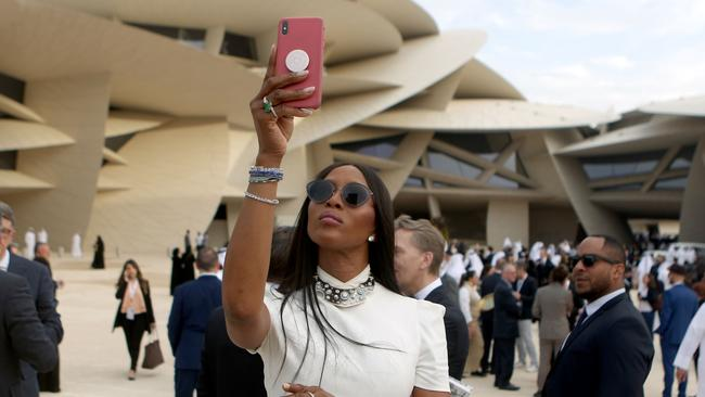 Naomi Campbell takes pictures upon her arrival to the inauguration ceremony of the National Museum of Qatar. Picture: Patrick Baz