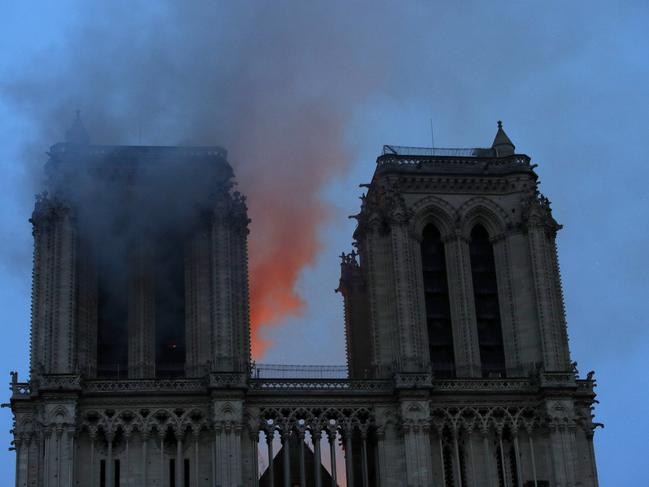 Smoke and flames fill the sky as a fire burns at the Notre Dame Cathedral. Picture: Philippe Wojazer