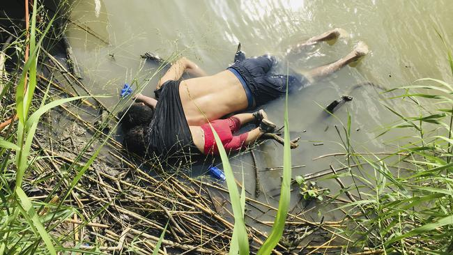 The bodies of Salvadoran migrant Oscar Alberto Martinez Ramirez and his nearly two-year-old daughter Valeria lie on the bank of the Rio Grande in Matamoros, Mexico. Picture: AP Photo/Julia Le Duc