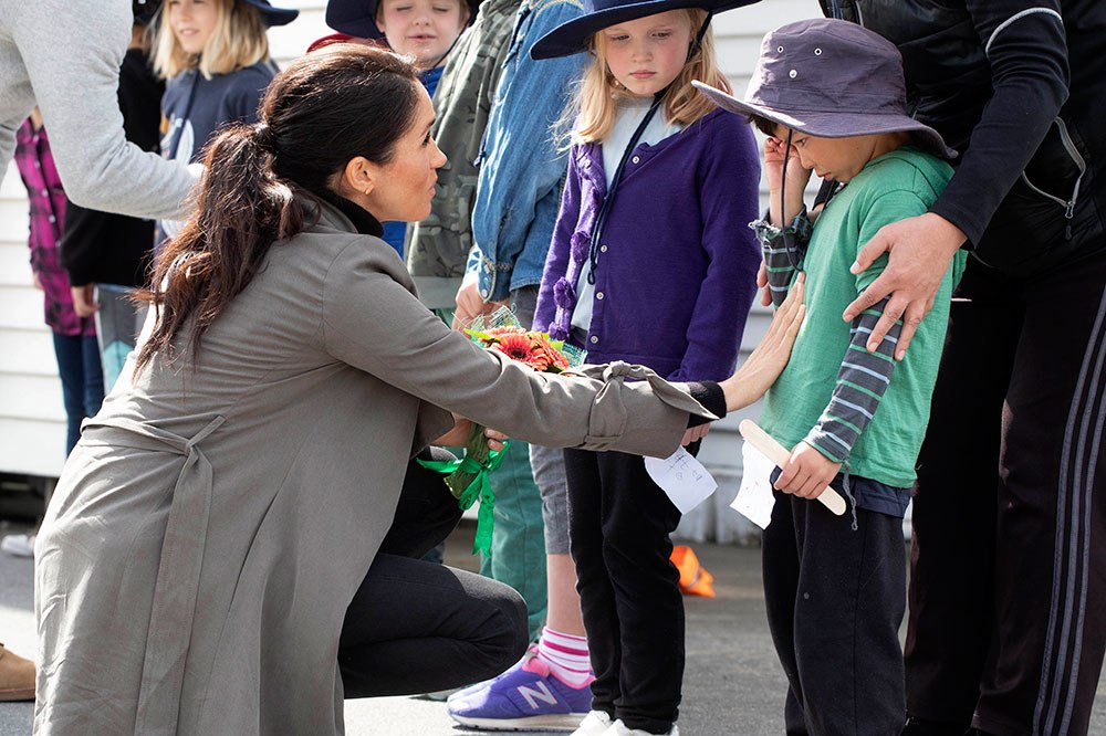 Meghan Markle comforts an overwhelmed school kid in Wellington, New Zealand 2018. Image credit: AP