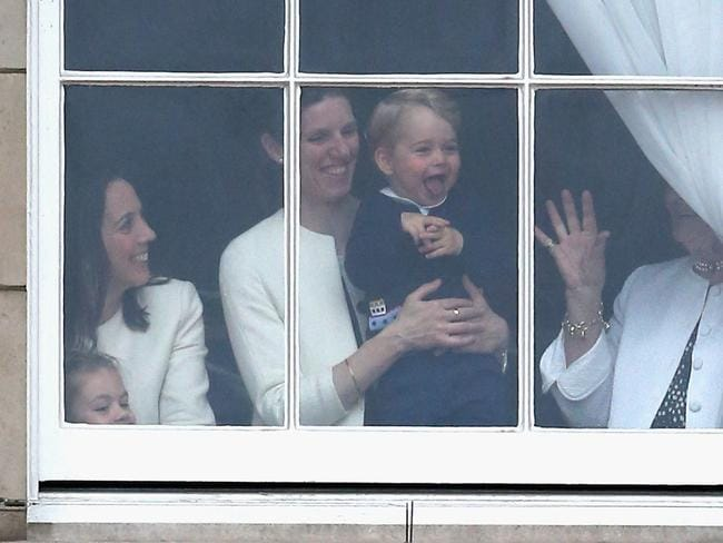 Prince George is held by his nanny Maria Teresa Turrion Borrallo as he waves from the window of Buckingham Palace in 2015. Picture: Chris Jackson/Getty Images