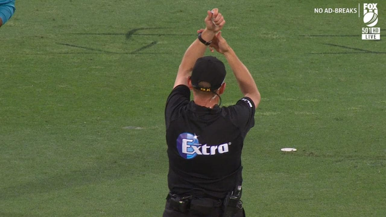 The umpire signals the Thunder's intention to take a time out at the end of the over.