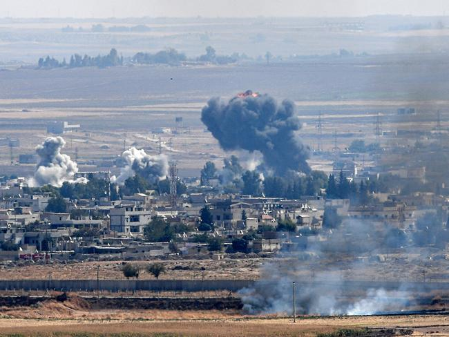 Smoke rising from the Syrian town of Ras al-Ain on the sixth day of Turkey's military operation against Kurdish forces. Picture: Ozan Kose/AFP