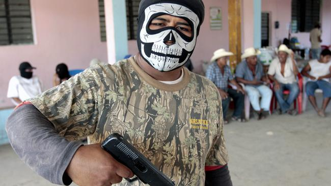 Many Mexican cops are corrupt in service of the cartels, so locals have to form their own vigilante groups to protect their neighbourhoods. This is one such man. Picture: Pedro Pardo / AFP