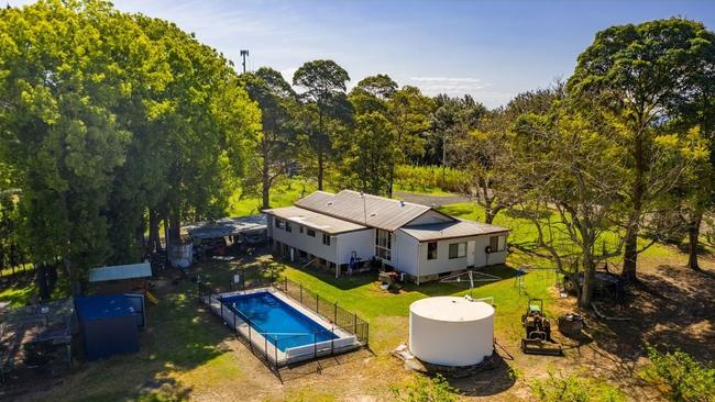 Weatherboard cottage with pool.