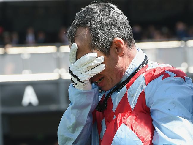 Red Cadeaux jockey Gerald Mosse was devastated post race. Picture: AP Photo/Andy Brownbill