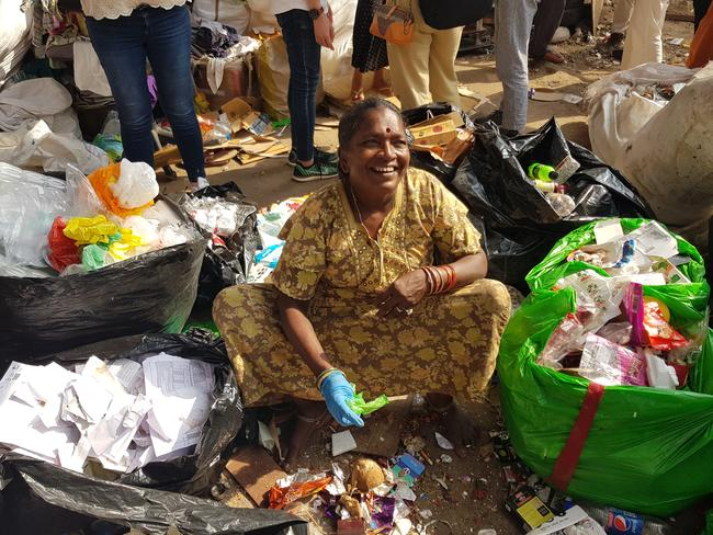 Veerana, 45, says she is 'very happy and proud' to work as a waste sorter and has paid for her children's education. Picture: Candy Sutton.