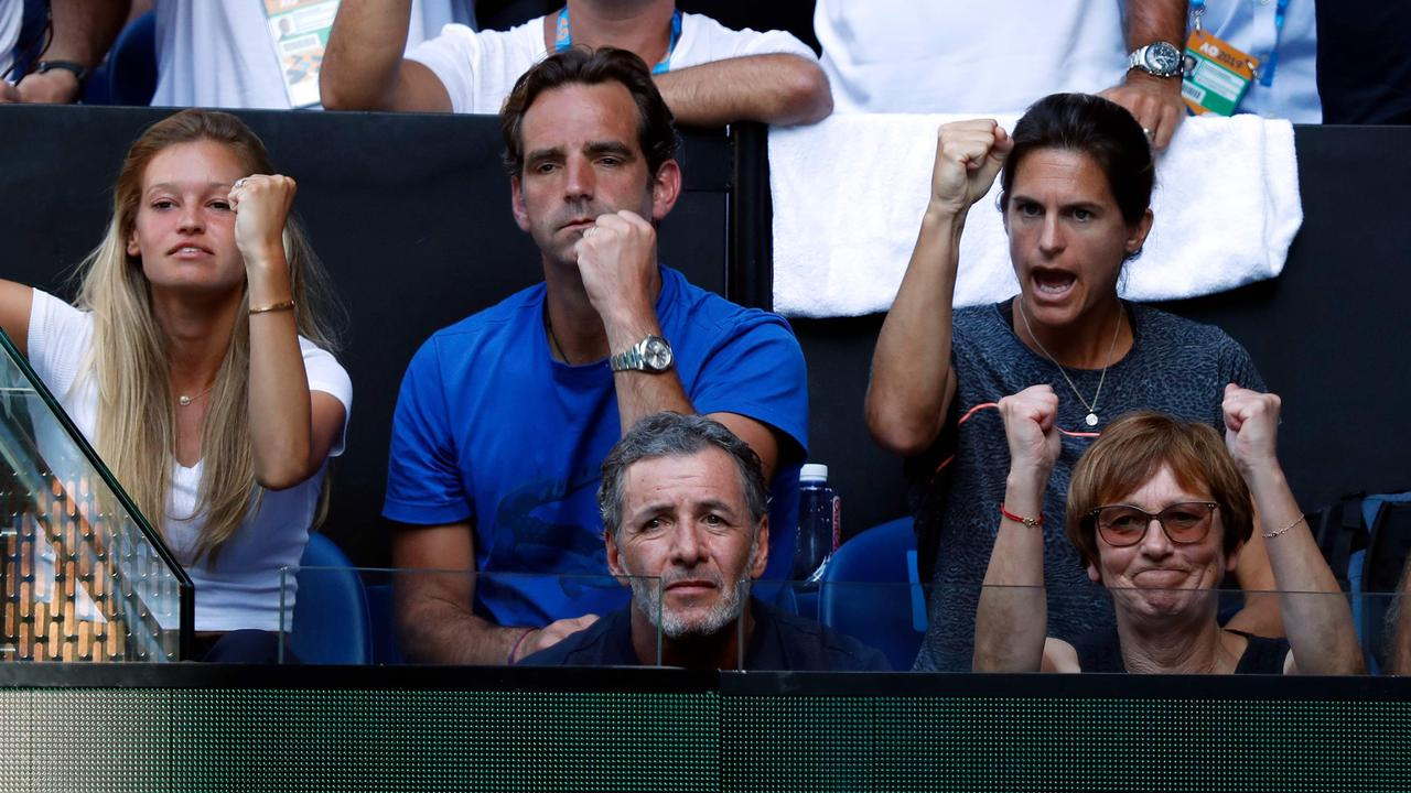 Women's tennis great Amelie Mauresmo (second row, right) has coached Lucas Pouille into the Australian Open semi-finals. (Photo by DAVID GRAY / AFP)