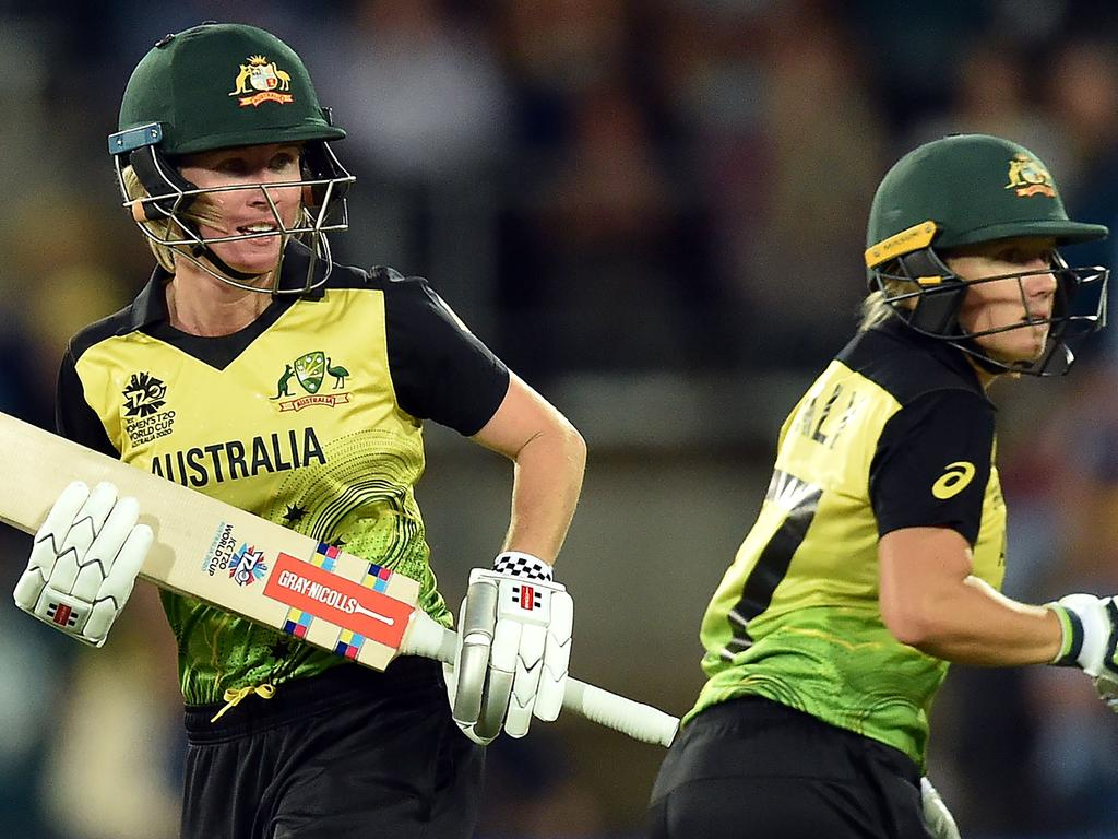 Australia's Beth Mooney (L) and Alyssa Healy run between the wickets during the Twenty20 women's World Cup cricket match between Australia and Bangladesh in Canberra on February 27, 2020. (Photo by Peter PARKS / AFP) / / IMAGE RESTRICTED TO EDITORIAL USE - STRICTLY NO COMMERCIAL USE