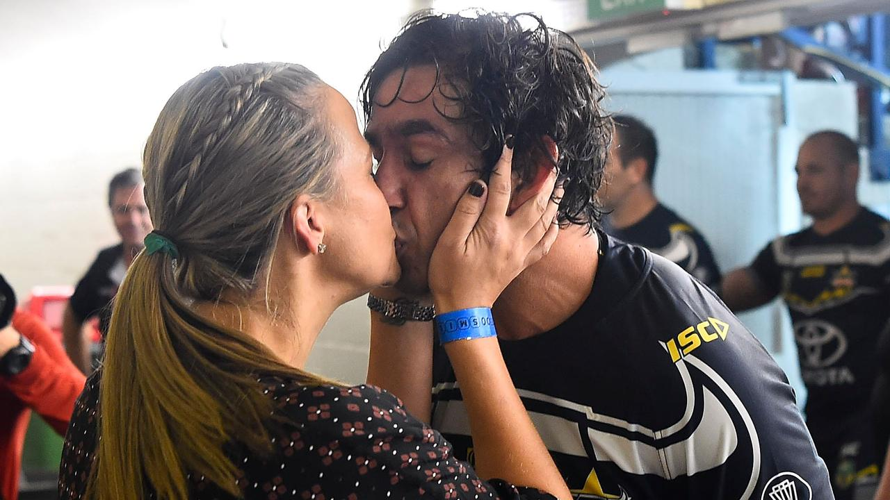 Johnathan Thurston of the Cowboys kisses his wife Samantha after playing his last home NRL match in Townsville.