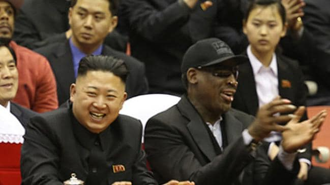 Former NBA star Dennis Rodman (front R) applauding as he sits next to North Korean leader Kim Jong-un (front L) with other spectators at a basketball game in Pyongyang. Picture: AFP