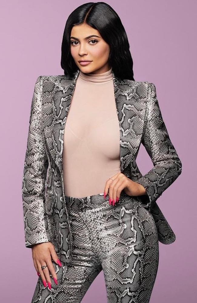 Kylie Jenner has been named the youngest billionaire ever at the age of 21, but judging from her reaction she's not bothered by the accolade. Picture: Forbes
