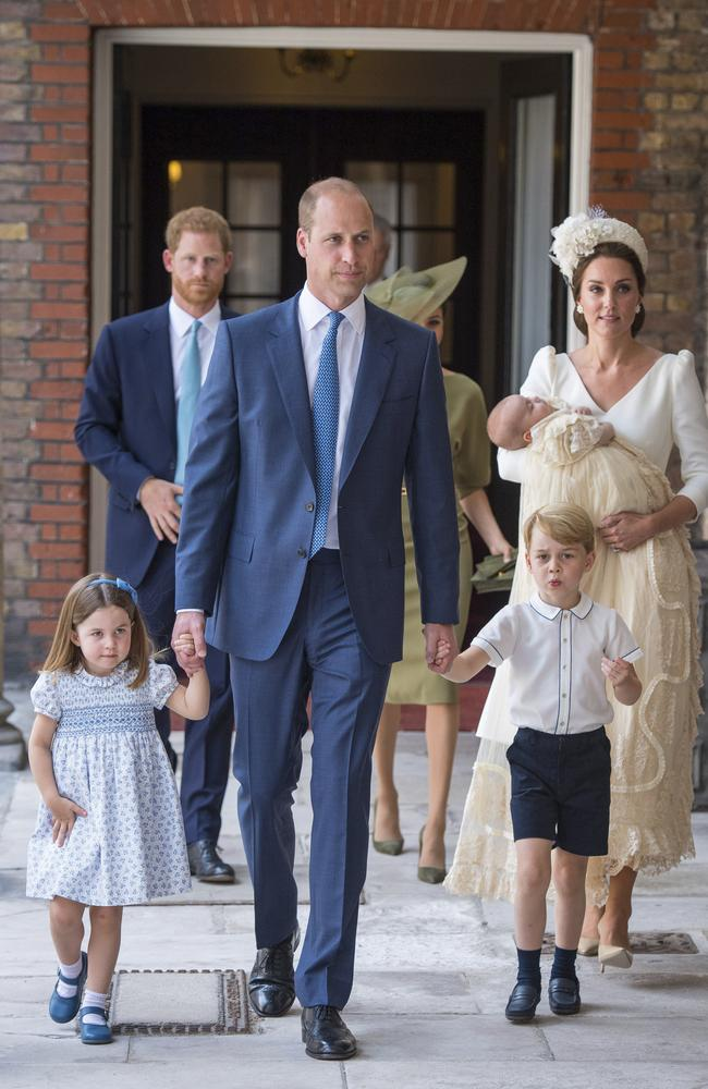 Prince William held the hands of the couple's two older children, Princess Charlotte and Prince George, as the family arrived for the service. Picture: Dominic Lipinski/Pool Photo via AP