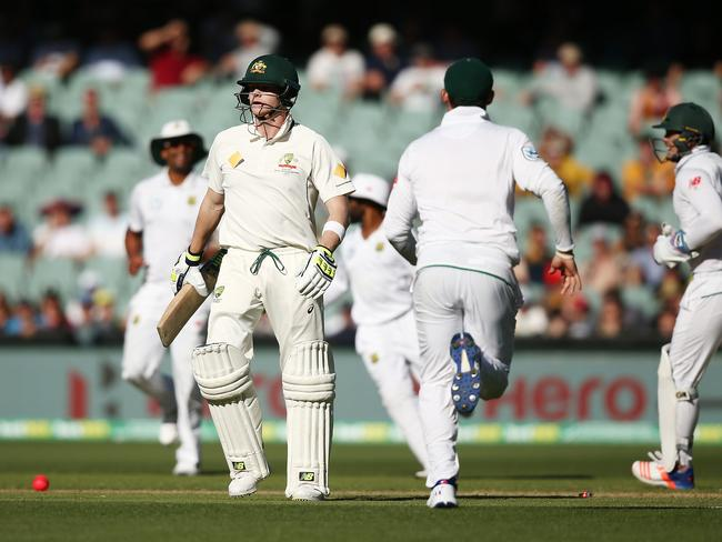 Steve Smith leaves the crease in anger after being run-out.
