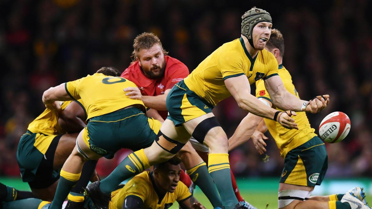 David Pocock of Australia passes the ball at Principality Stadium.