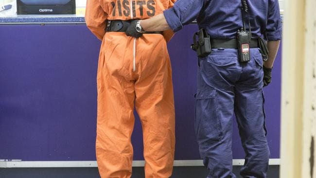 A prisoner is escorted by the High Risk Escort Unit to Goulburn's 'Supermax' prison.