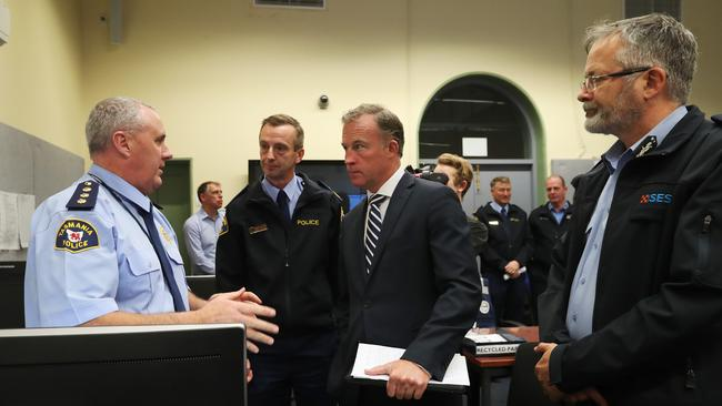 Premier Will Hodgman speaks with Inspector John Ward, of Tasmania Police, with Tasmania Police Commisioner Darren Hine and SES director Andrew Lea. Picture: NIKKI DAVIS-JONES