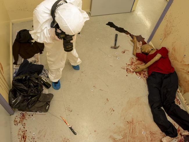 A student documents the obvious weapon in this crime scene. Or is it? Photo: Richard Tuffin