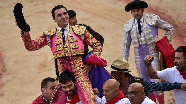 Sickening: Bullfighter Octavio Chacon is carried by assistants at the end of the bullfight. Picture: AP/Alvaro Barrientos