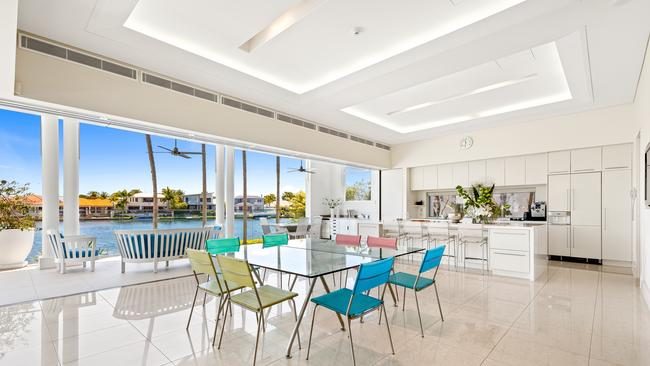 The kitchen and dining area of the home at 32-36 The Anchorage, Noosa Waters.