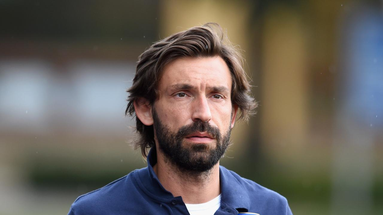 Andrea Pirlo looks on before an Italy training session