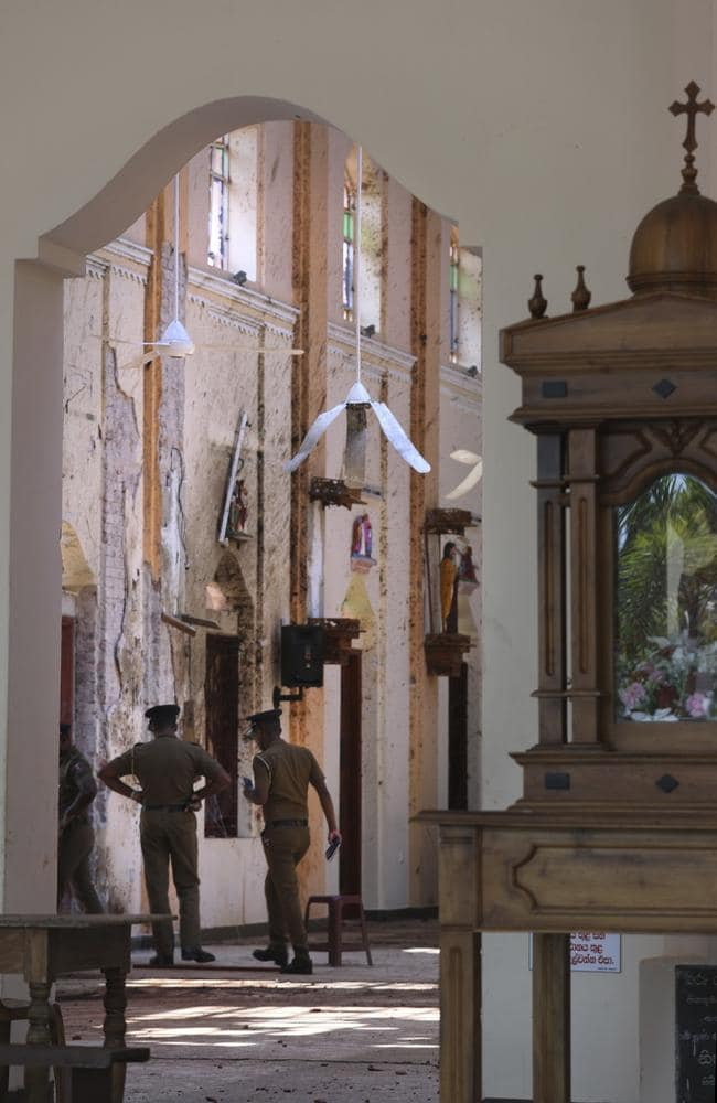 Sri Lankan policemen keep vigil at St. Sebastian's Church, where a suicide bomber blew himself up on Easter Sunday. Picture: AP