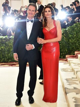 Rande Gerber and Cindy Crawford, in a red Versace gown, at the 2018 Met Gala. Picture: AFP