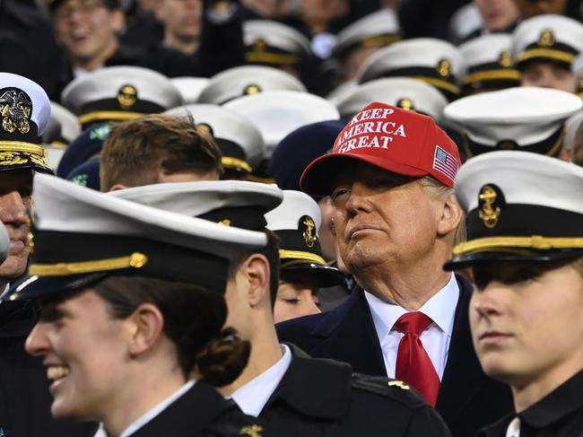 US President Donald Trump joins Naval Academy cadets during the Army v. Navy American Football game in Philadelphia. Picture: Andrew Caballero-Reynolds/AFP