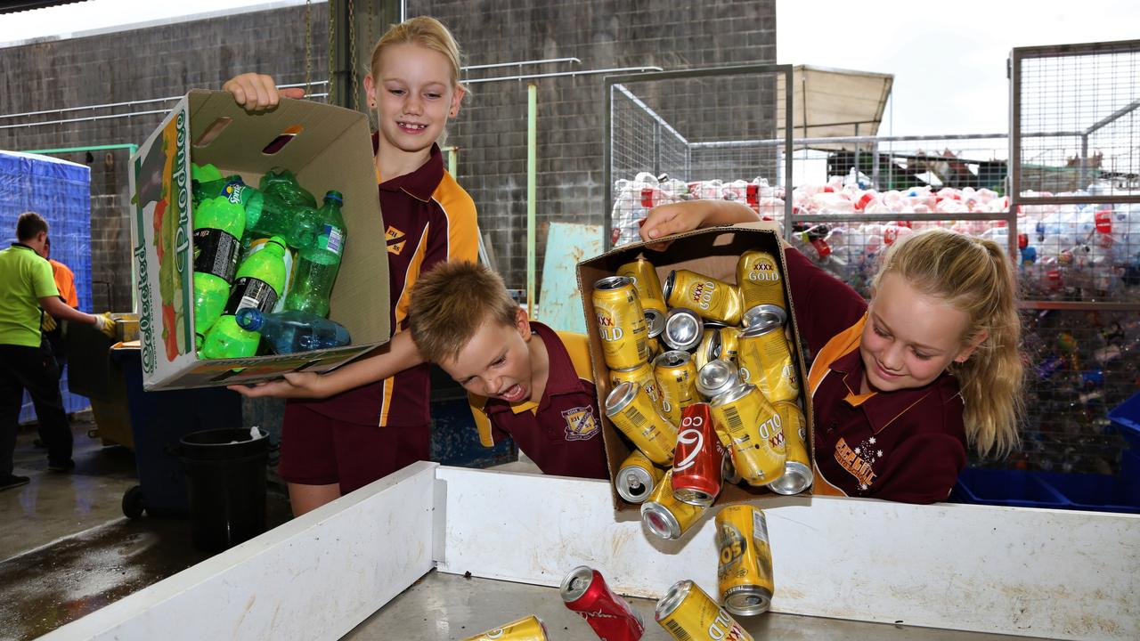 Edge Hill State School students Abby, Ben and Hannah Bissett deposit bottles and cans at North Queensland Recycling Agents in Bungalow. Picture: Peter Carruthers