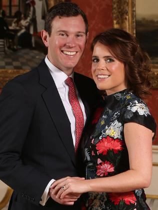 Princess Eugenie (right) with fiance Jack Brooksbank. Picture: AFP/Jonathan Brady