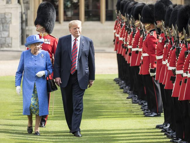 Donald Trump makes a faux pas by walking ahead of the Queen. Picture: Richard Pohle/WPA Pool/Getty Images