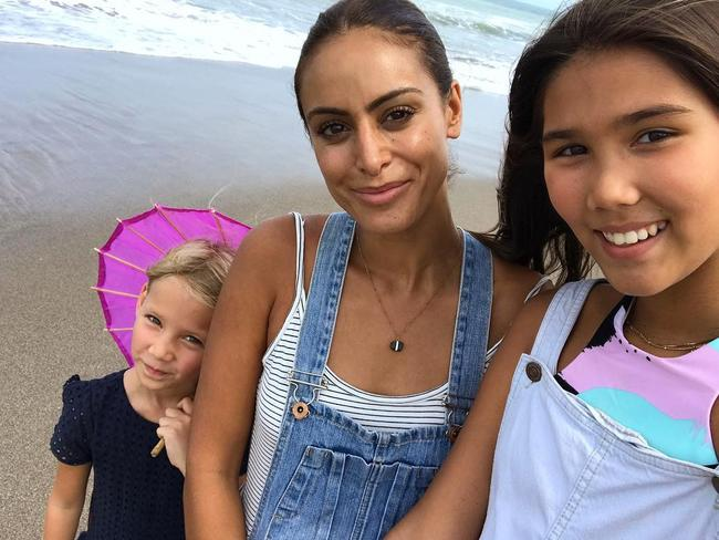 Michael Klim's new girlfriend Desiree Deravi with his daughters, Frankie, left, and Stella, right. Picture: Instagram
