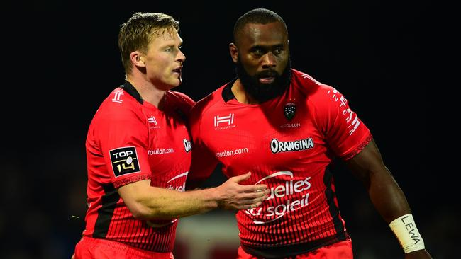 Chris Ashton (L) celebrates with teammate Semi Radradra after scoring a tryagainst Agen at the Armandie stadium in Agen.