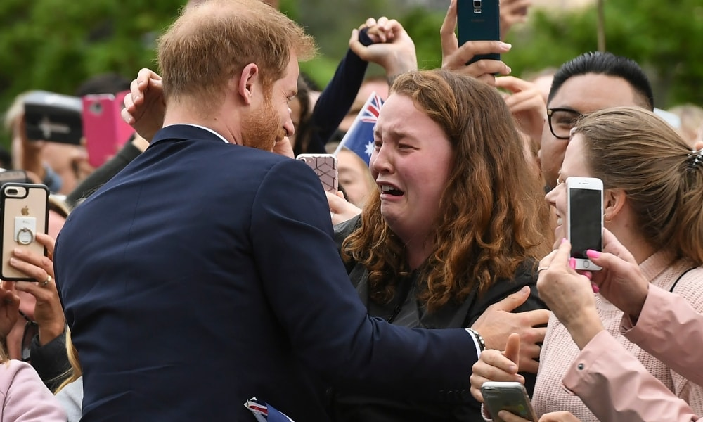 "<b>Prince Harry and his fellow gingers</b>  <p>While royal watchers the country over have turned out to see the Duke and Duchess of Sussex, it is Prince Harry's fellow gingers who have seemed most eager to lay their eyes on the royal. India Brown had her day made in Melbourne when she asked Harry for a hug and he obliged, saying, ""You're going to get me in trouble."" India was holding up a sign that read 'Been here since 4am, loved you since I was 8!!'. </p>  <p><i>Picture: AFP</i></p>"