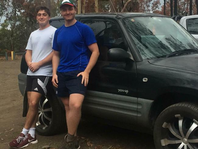 Brad Warren (left) and Oliver Walker with their Rav 4 before they rolled it. Picture: Brad Warren/Caters News