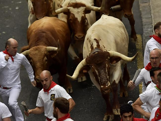People try to evade the fighting bulls. Picture: AP