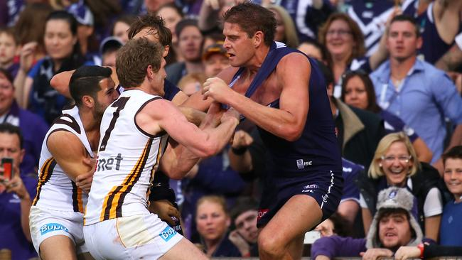 Aaron Sandilands remonstrates with Paul Puopolo and Ben McEvoy. Picture: Getty
