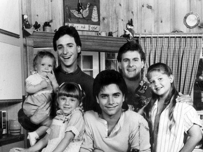 Ashley (or Mary Kate) Olsen with Bob Saget, David Cooulier, Candace Cameron, John Stamos and Jodie Sweetin from Full House.