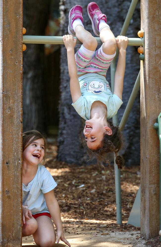 Alessandra Healy, 4, and Alicia Butt, 4, playing in the playground at Emanuel Pre-Schoo. Picture: Justin Lloyd