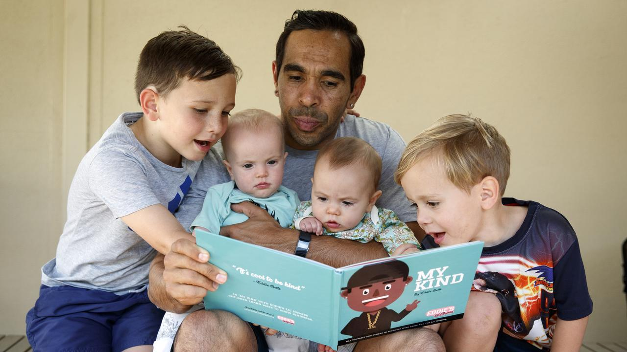 Eddie Betts with his children Lewis, twins Alice and Maggie and Billy reading his children's book in 2018. Picture: Matt Turner