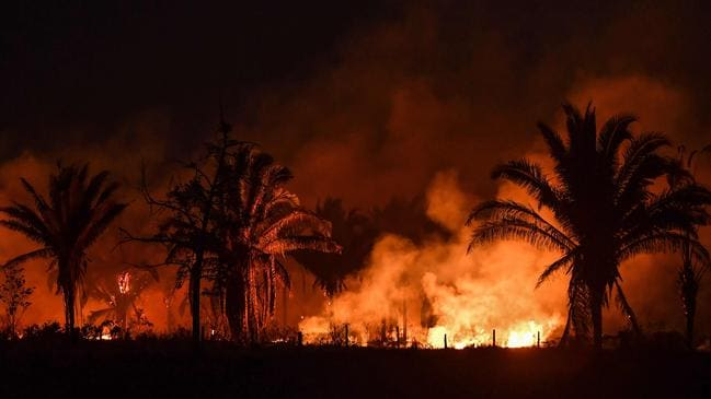 Fires in the Amazon rainforest are burning at a record rate, but Brazil's President Jair Bolsonaro denies there's a problem. Picture: Nelson Almeida/AFP