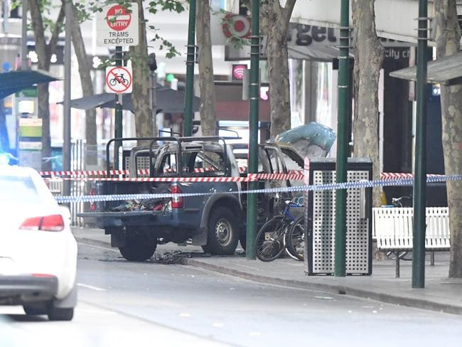 The burnt out vehicle seen on Bourke Street after the attack. Picture: James Ross