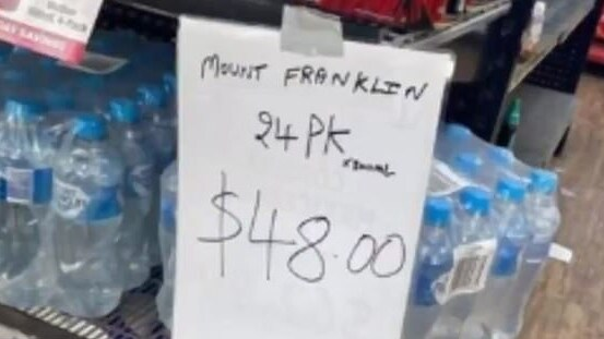 People expressed outrage at apparent price gouging, such as this $48 tag for 24 bottles of water.