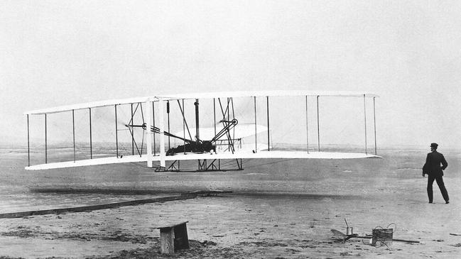 Orville Wright at the controls of the Wright Flyer as brother Wilbur looks on during plane's first flight at Kitty Hawk on this day in 1903. Picture: AP Photo/John T. Daniels