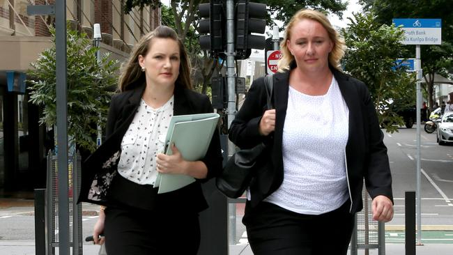 Amy Robinson (right), arrives at court for a trial with Lorna Jane about bullying in the workplace. Picture: Steve Pohlner