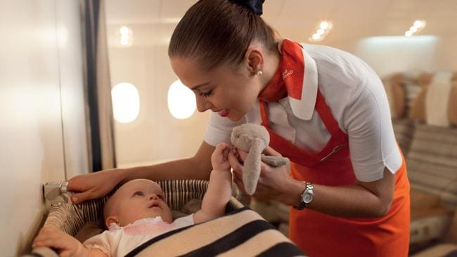A flying nanny entertaining a baby on board. Picture: Supplied