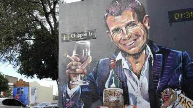Street art in Chippendale, inner Sydney, by artist Scott Marsh depicting the premier as 'Casino Mike' enjoying a late night booze up at the casino while elsewhere in central Sydney having a drink would be banned.