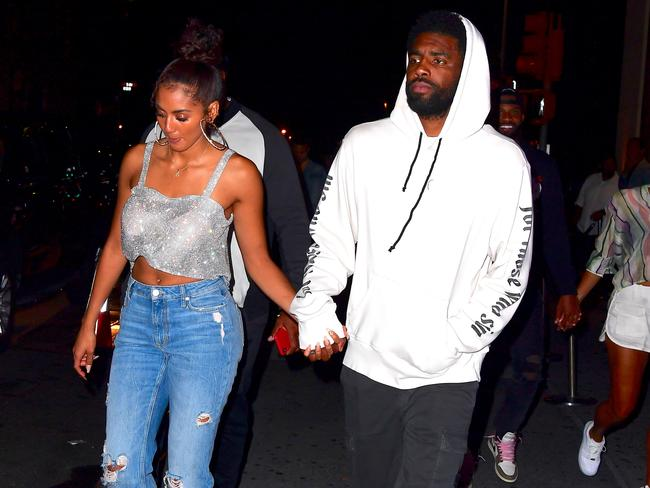 Kyrie Irving and girlfriend Marlene Wilkerson aka 'Golden' look to be engaged with a huge ring visible on her ring finger. Picture: @Lionssharenews