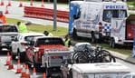 Police controlled vehicle checkpoints at the Gold Coast Highway as the Queensland borders opened. (Photo/Steve Holland)