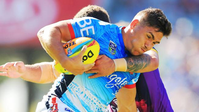 Chris Smith of the Roosters in action.